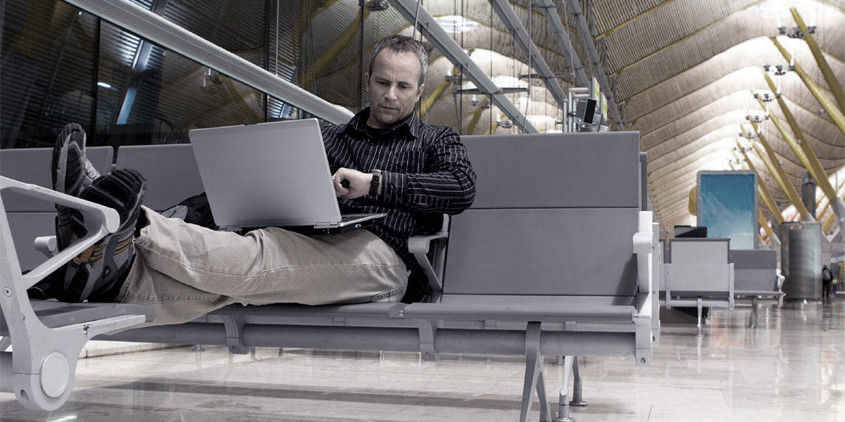 person-with-laptop-in-airport-3.jpg
